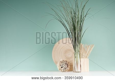 Minimalist Cozy Interior With Beige Natural Organic Home Decor - Bamboo Plate, Bouquet Of Herb In Bo