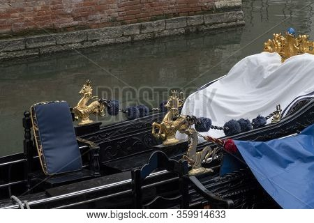 Detail Of Venetian Gondola In Green Canal Waters Of Venice Italy