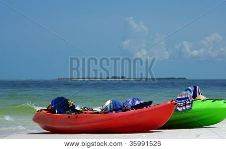 colorful kayaks on the beach