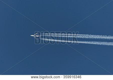 TISZAFURED, HUNGARY - CIRCA 2018: Thia Airways Boeing 747-400 passing overhead at cruising altitude