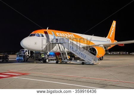 BUDAPEST, HUNGARY - CIRCA 2019: EasyJet A320 ground handling at night at Budapest Liszt Ferenc Airport Easyjet is the second largest low-cost airline of Europe.