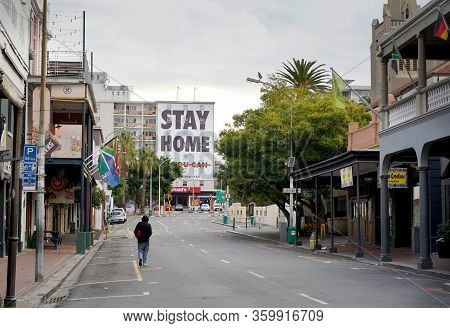 Cape Town, South Africa - 6 April 2020 : Empty Streets With Lonely Figure And Stay Home Sign In Cape