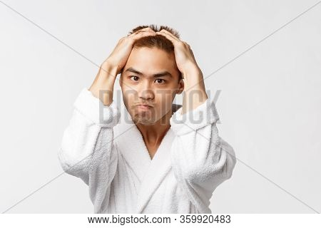Beauty, Spa And Leisure Concept. Portrait Of Sick And Tired, Tensed Angry Asian Man Holding Hands On