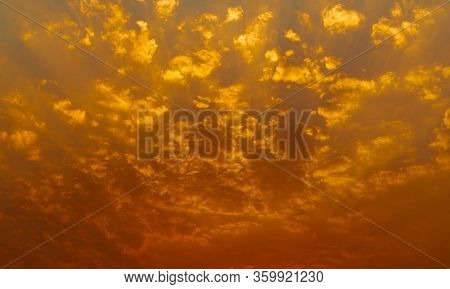 Beautiful Sunset Sky. Golden Sunset Sky With Beautiful Pattern Of Clouds. Orange, Yellow, And Red Cl