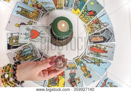 Bangkok,thailand,march.15.20:a Fortune Teller Holds A Magic Ball.on The Table Are Fortune-telling Ca
