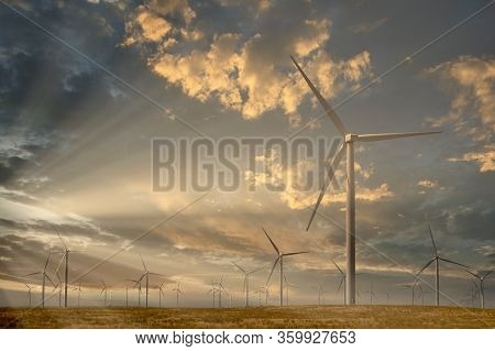 Giant Wind Mill Generators In The Morning Light