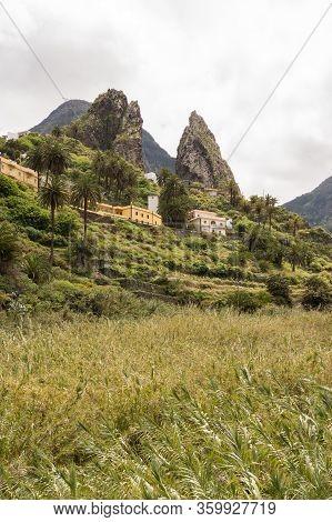 Roques De Pedro And Petra Seen From The Valley At La Hermigua On La Gomera. April 15, 2019. La Gomer
