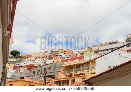 Picturesque Houses Hanging From The Side Of A Mountain In San Sebastian De La Gomera. April 15, 2019