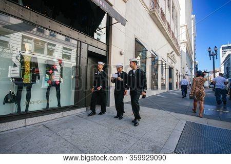 San Francisco, Usa - Oct 1, 2012: Three Us Navy Sailors On Leave In Dark Uniform Walk Down The Stree