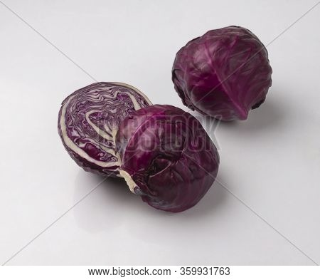 Fresh Purple Cabbages Isolated On White Background