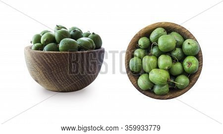 Green Baby Kiwi Fruit Actinidia Isolated On White Background. Actinidia In A Bowl With Copy Space Fo