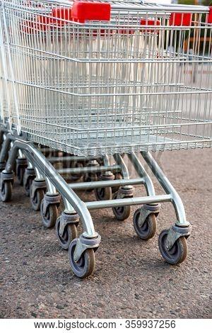 Empty Shopping Carts Near A Supermarket