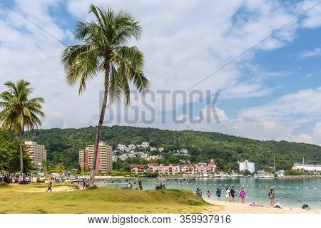 Ocho Rios, Jamaica - April 22, 2019: People Relax On The Ocho Rios Bay Beach Also Referred To As Tur