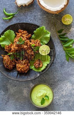 Indian Cuisine, Indian Food. Pakora Traditional Indian Deep-fried Snack. Pakoras On Black Platter Wi