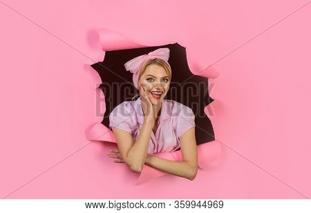 Through Paper. Woman Peeks Through Hole In Paper. Pin Up Woman Looking Through Paper. Pin Up Woman L