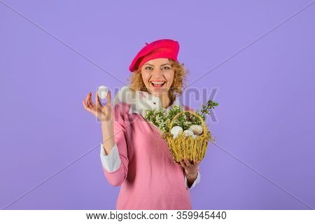 Girl In Fashionable Beret Hold Basket With Eggs. Basket With Eggs. Easter Bunny Rabbit. Small Bunny