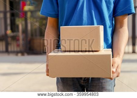 Asian Delivery Man Wearing Mask Send A Package Holding Parcel Cardboard On Front Receiver Shipping D