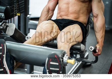 Gym Fitness Club Indoor With Young Man Training Weights With Legs.
