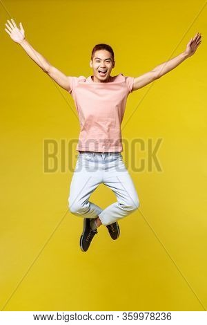 Vertical Portrait Of Wild And Free, Enthusiastic Asian Male Student Finally Passed All University Ex