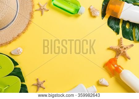 Beach Accessories With Straw Hat, Sunscreen Bottle And Seastar On Yelow Background Top View With Cop