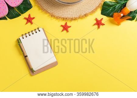 Beach Accessories With Straw Hat, Sunscreen Bottle And Seastar On Yellow Background Top View With Co