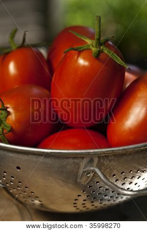 Colander And Tomatoes