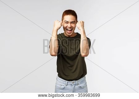 Cheerful Happy, Luck Asian Male Student Winning Competition, Achieve Goal, Celebrate Success With Be