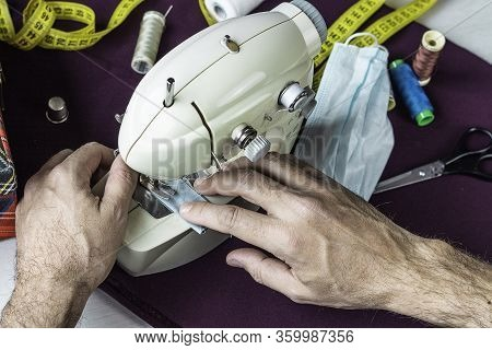 Male Hands Sewing Homemade Surgical Masks  Conceptual Health Emergency, Action In The Absence Of Per