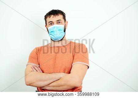 Portrait Of Strong Man Wear Face Mask. Protection Against Contagious Disease, Coronavirus. Man Weari