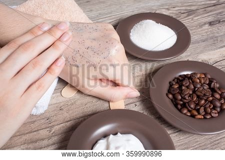 A Woman Applies Of Coffee Homemade Scrub On Her Hand. Spa, Beauty. Ingredients For Making A Scrub, C