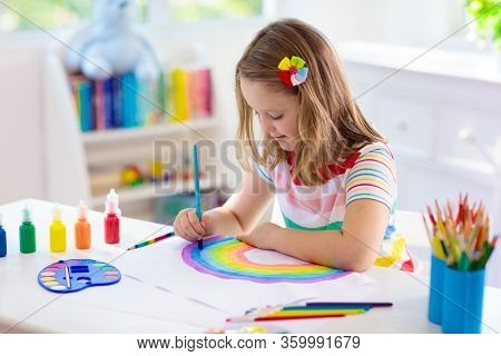 Kids Paint. Child Painting In White Sunny Study Room. Little Girl Drawing Rainbow.