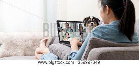 Banner Of Asian Woman On Sofa And Team On Laptop Screen Talking And Discussion In Video Conference A