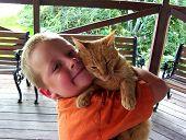 boy hugging cat. poster