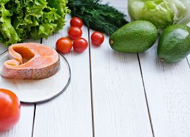 Healthy Meal Tomatoes, Fish, Greens And Avocado. Healthy Eating, Dieting, Slimming And Weigh Loss Co