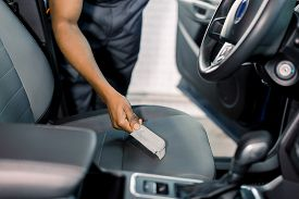 Hand Of Car Service Male Dark Skinned Worker Cleaning Car Seat With Brush Inside. Cleaning The Car W