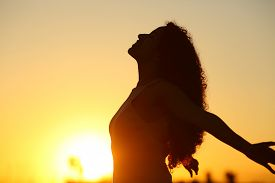 Side View Silhouette Of A Lady Breathing Deeply Fresh Air At Sunset
