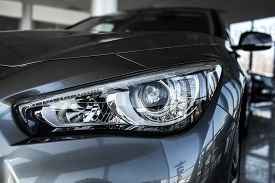 Modern Luxury Car Close-up. Concept Of Expensive, Sports Auto. Headlight Lamp Of New Cars, Copy Spac