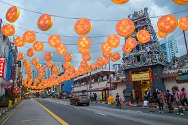 Singapore, Singapore - February 2, 2015: People On A Street Decorated For Upcoming Chinese New Year
