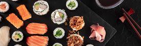 Large Sushi Set Overhead Panoramic Shot With Soy Sauce And Chopsticks. An Assortment Of Various Maki