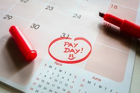 Payday end of month date on calendar with red marker and circled salary day