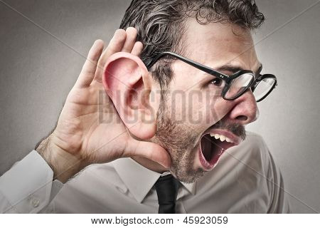 young businessman tries to listen poster