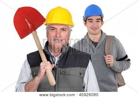 Experienced tradesman standing in front of his apprentice