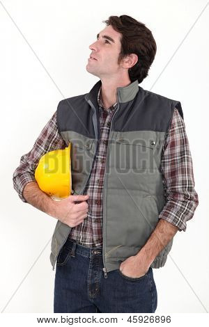Construction worker staring off into space