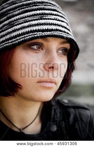 Closeup woman face in grunge style with tears