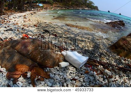 Coast of tropical sea poluted with plastic