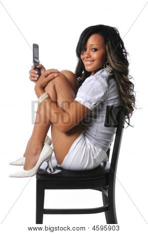 Woman With Cell Phone On Chair