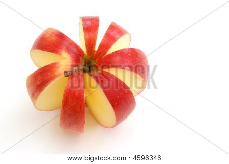 poster of An apple is sliced to make a flower shape.