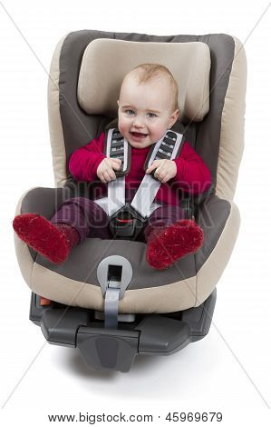 Child In Booster Seat For A Car In Light Background