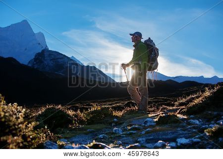 Hiking in Khumbu walley in Himalayas mountains poster