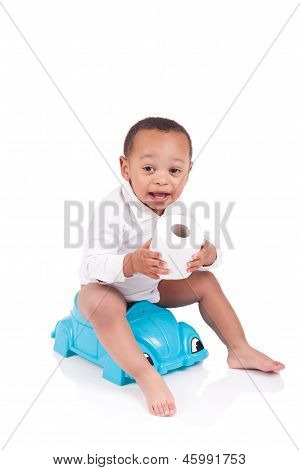 African Child On Potty Play With Toilet Paper, Isolated Over White